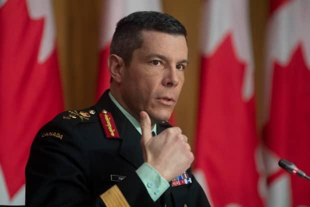 Maj.-Gen. Dany Fortin, shown here responding to a question on COVID vaccines during a news conference, has left his post at PHAC pending the results of a military investigation. (Adrian Wyld/The Canadian Press - image credit)