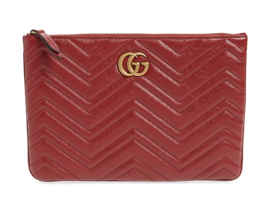 <p>If they're fans of the color red, go for this bold <span>Saint-Laurent Monogram Leather Card Case</span> ($830).</p>