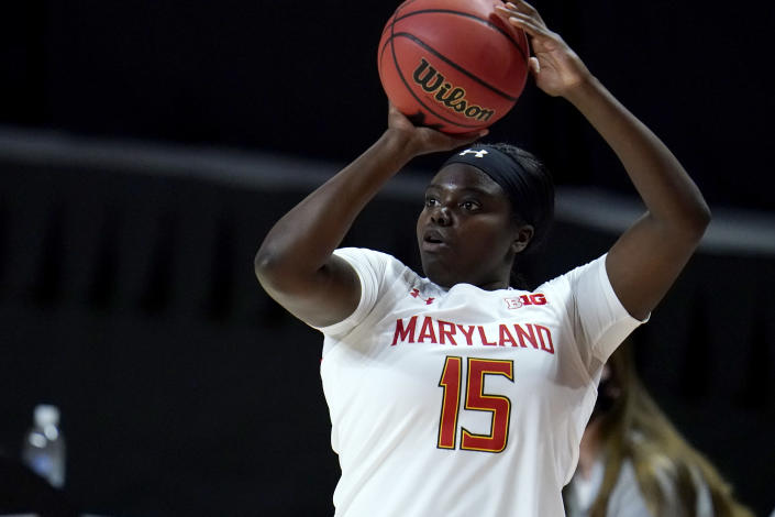Maryland guard Ashley Owusu shoots a basket against Wisconsin during the first half of an NCAA college basketball game, Thursday, Feb. 4, 2021, in College Park, Md. (AP Photo/Julio Cortez)