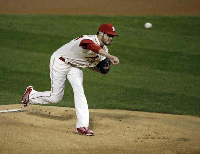 St. Louis Cardinals starting pitcher Joe Kelly throws during the first inning of Game 3 of baseball's World Series against the Boston Red Sox Saturday, Oct. 26, 2013, in St. Louis. (AP Photo/Charlie Neibergall)