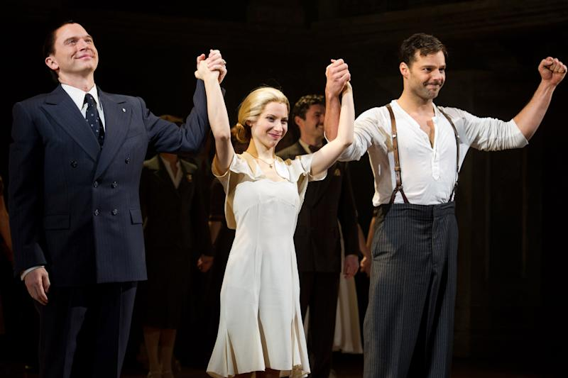 """FILE - In this March 12, 2012 file photo, from left, Michael Cerveris, Elena Roger and Ricky Martin appear at the curtain call after their first performance in the new Broadway production of """"Evita"""", in New York. (AP Photo/Charles Sykes)"""