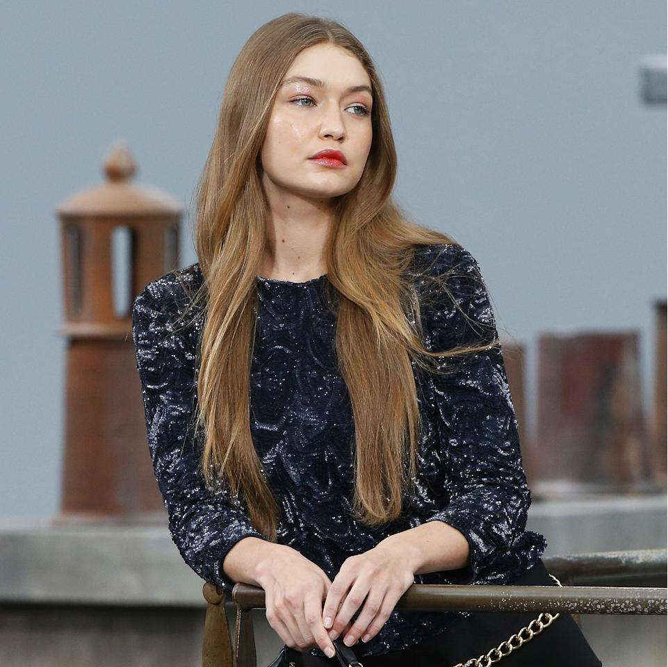 """<p>For Chanel's Spring 2020 show, hairstylist Sam McKnight was inspired by the women of the '60s and '70s and the way their volumized hair fell like curtains. Models such as Gigi Hadid and Kaia Gerber wore long, thick, straight hair on the runway. McKnight gently curled the ends of models' hair and parted it down the middle, followed by a heavy dose of <a href=""""https://www.net-a-porter.com/us/en/product/998866/hair_by_sam_mcknight_/lazy-girl-dry-shampoo--250ml"""" rel=""""nofollow"""">McKnight's own dry shampoo</a> for added texture.</p> <p>Lucia Pica, Chanel's global creative makeup and color designer, created a sun-kissed look with rose gold lids and a just-bitten lip using <a href=""""https://www.chanel.com/us/makeup/p/162954/rouge-allure-liquid-powder-liquid-matte-lip-colour-powder-effect/"""" rel=""""nofollow"""">Rouge Allure Liquid Powder in Radical</a> with clear <a href=""""https://www.chanel.com/us/makeup/p/156728/rouge-coco-gloss-moisturizing-glossimer/"""" rel=""""nofollow"""">Rouge Coco Gloss</a>. She also applied <a href=""""https://www.chanel.com/us/makeup/p/191710/le-volume-revolution-de-chanel-extreme-volume-mascara-3d-printed-brush/"""" rel=""""nofollow"""">Le Volume Revolution</a> mascara and added faux freckles to cheeks using eyebrow pencils that matched the models' brows.</p>"""