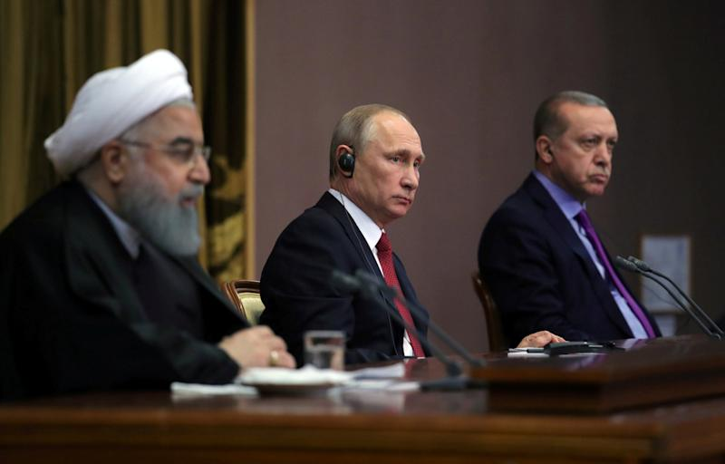 Iran's President Hassan Rouhani together with his counterparts, Russia's Vladimir Putin and Turkey's Tayyip Erdogan, attend a joint news conference following their meeting in Sochi, Russia November 22, 2017. Sputnik/Mikhail Klimentyev/Kremlin via REUTERS