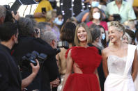 Rosamund Pike, left, and Sharon Stone pose for photographers upon arrival at the awards ceremony and premiere of the closing film 'OSS 117: From Africa with Love' at the 74th international film festival, Cannes, southern France, Saturday, July 17, 2021. (Photo by Vianney Le Caer/Invision/AP)