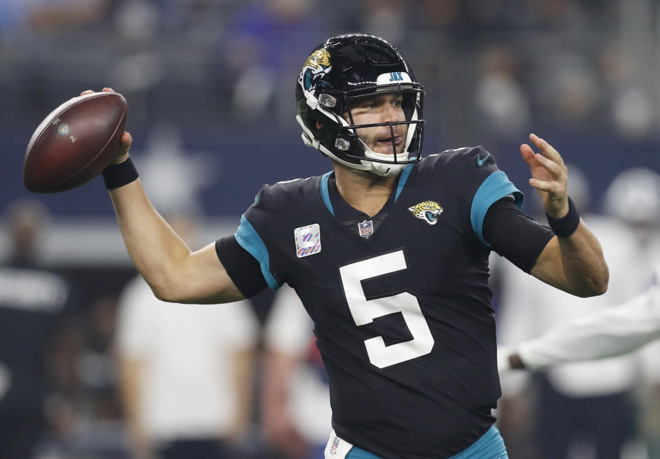 Jacksonville Jaguars quarterback Blake Bortles (5) throws in the first half of an NFL football game against the Dallas Cowboys in Arlington, Texas, Sunday, Oct. 14, 2018. (AP Photo/Jim Cowsert)