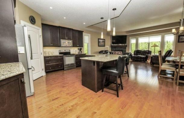 """<p><a href=""""https://www.zoocasa.com/search?listing-id=4564265"""" rel=""""nofollow noopener"""" target=""""_blank"""" data-ylk=""""slk:18343 Lessard Rd. Northwest"""" class=""""link rapid-noclick-resp"""">18343 Lessard Rd. Northwest</a><br>Here's a view of the open concept kitchen/dining/living room. </p>"""