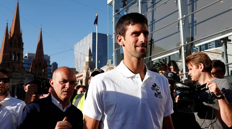 Serbia's Novak Djokovic arrives to attend a publicity event ahead of the Australian Open tennis tournament in Melbourne, Australia