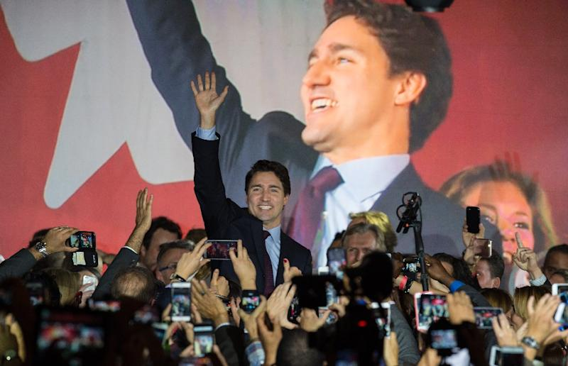 Canadian Liberal Party leader Justin Trudeau arrives on stage in Montreal on October 20, 2015 after winning the general election (AFP Photo/Nicholas Kamm)
