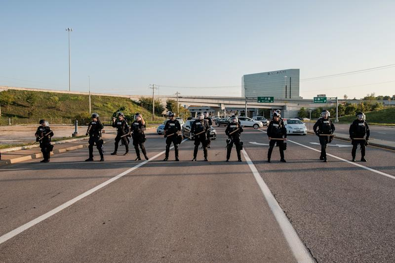 Riot police block Brentwood Boulevard by the St. Louis Galleria in Clayton, Missouri, as protesters attempt to march down the road Wednesday.