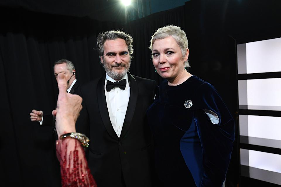 HOLLYWOOD, CALIFORNIA - FEBRUARY 09: In this handout photo provided by A.M.P.A.S. Best Actor award winner Joaquin Phoenix and Olivia Colman stand backstage during the 92nd Annual Academy Awards at the Dolby Theatre on February 09, 2020 in Hollywood, California. (Photo by Richard Harbaugh - Handout/A.M.P.A.S. via Getty Images)