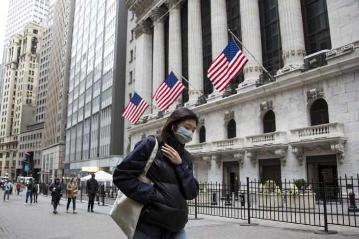 A woman wearing a protective mask walks past the New York Stock Exchange on March 12, 2020. in New York City. (Photo: Pablo Monsalve/VIEWpress/Corbis via Getty Images)