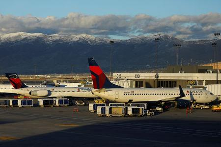 FILE PHOTO: Delta Air Lines planes are shown parked at their gates at the airport in Salt Lake City, Utah, U.S., January 12, 2018. REUTERS/Mike Blake/File Photo