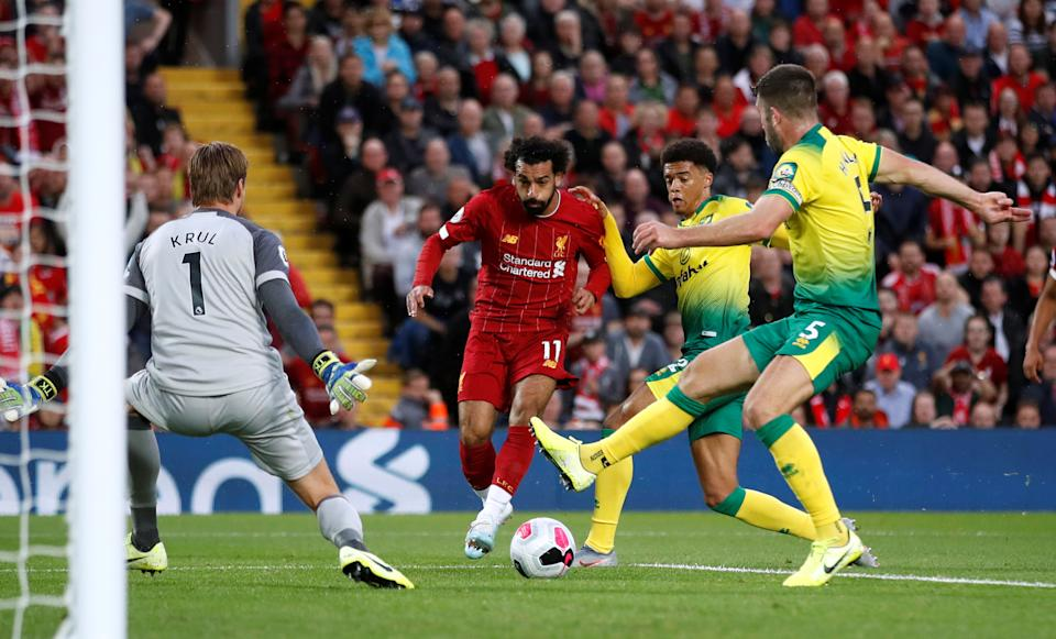 """Soccer Football - Premier League - Liverpool v Norwich City - Anfield, Liverpool, Britain - August 9, 2019   Liverpool's Mohamed Salah scores their second goal    Action Images via Reuters/Carl Recine    EDITORIAL USE ONLY. No use with unauthorized audio, video, data, fixture lists, club/league logos or """"live"""" services. Online in-match use limited to 75 images, no video emulation. No use in betting, games or single club/league/player publications.  Please contact your account representative for further details."""