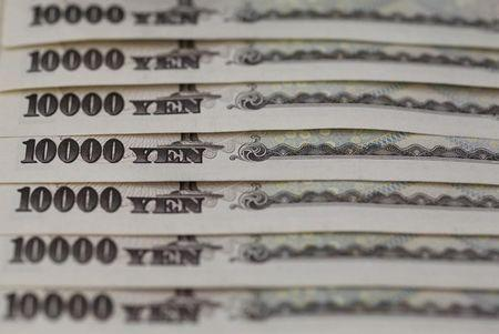 Japanese 10,000 yen notes lined up in this picture illustration