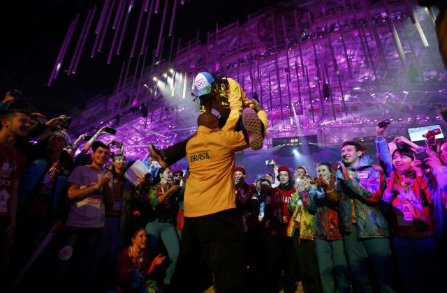 Participants dance during the party at the end of the closing ceremony for the Sochi 2014 Winter Olympics, February 23, 2014. REUTERS/Marko Djurica (RUSSIA - Tags: SPORT OLYMPICS)