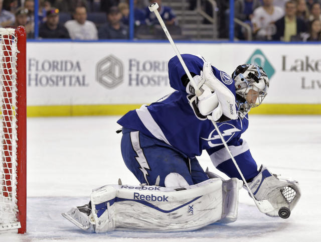 Tampa Bay Lightning goalie Ben Bishop makes a glove save on a shot by the Vancouver Canucks during the first period of an NHL hockey game Tuesday, Jan. 20, 2015, in Tampa, Fla. (AP Photo/Chris O'Meara)