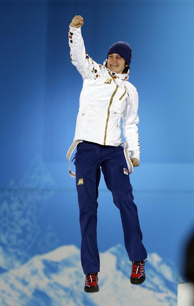 Martina Sablikova of the Czech Republic, who won the silver medal in women's 3,000-meter speedskating, jumps on the podium during the medals ceremony at the 2014 Winter Olympics, Monday, Feb. 10, 2014, in Sochi, Russia. (AP Photo/Morry Gash)