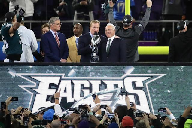 NFL commissioner Roger Goodell (middle) presents the Vince Lombardi trophy to Philadelphia Eagles owner Jeffrey Lurie after the Eagles defeated the New England Patriots 41-33 in Super Bowl LII at U.S. Bank Stadium. (Getty Images)