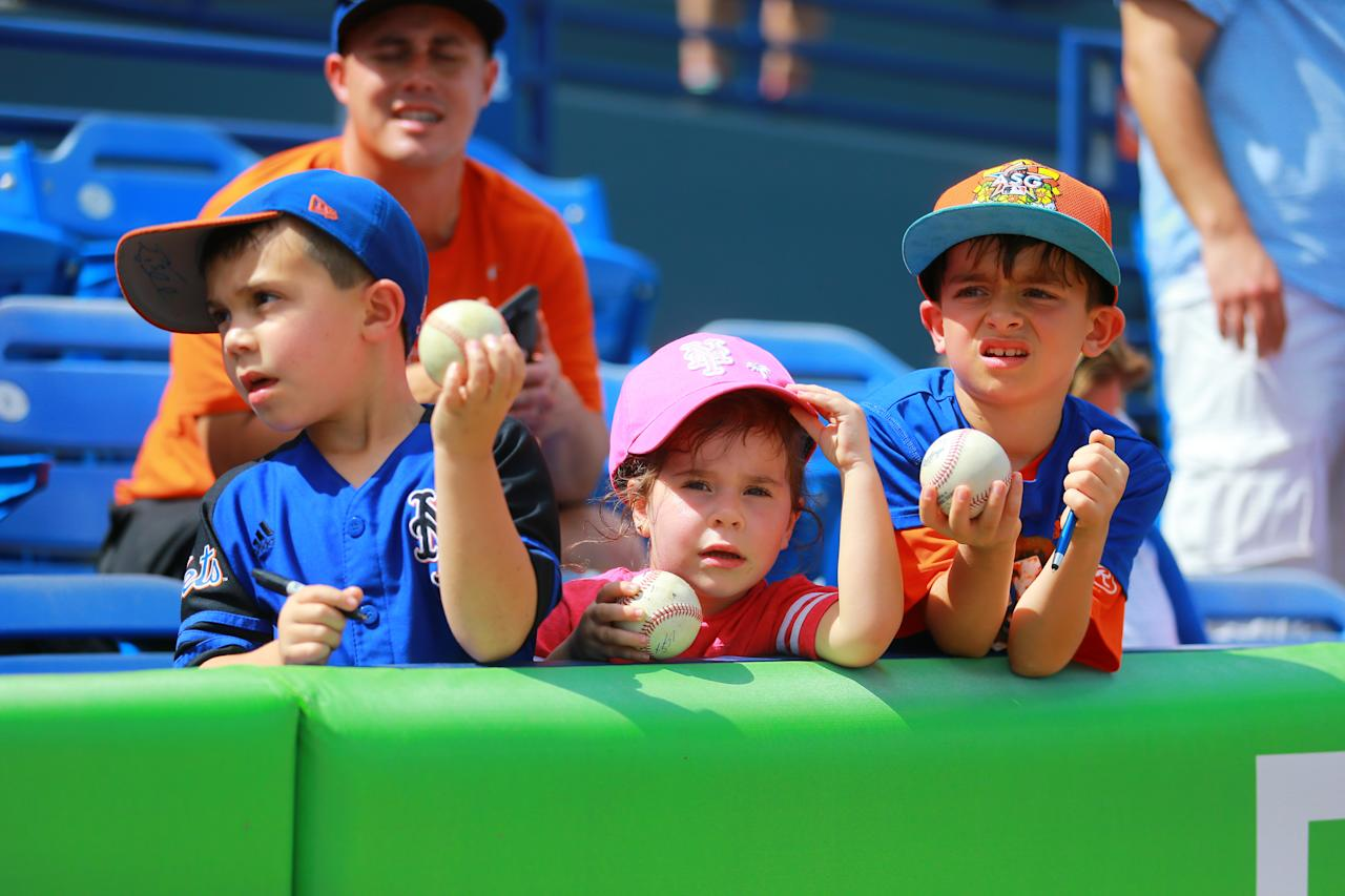 <p>Young fans seek autographs before a baseball game between the Miami Marlins and New York Mets at First Data Field in Port St. Lucie, Fla., Feb. 25, 2018. (Photo: Gordon Donovan/Yahoo News) </p>