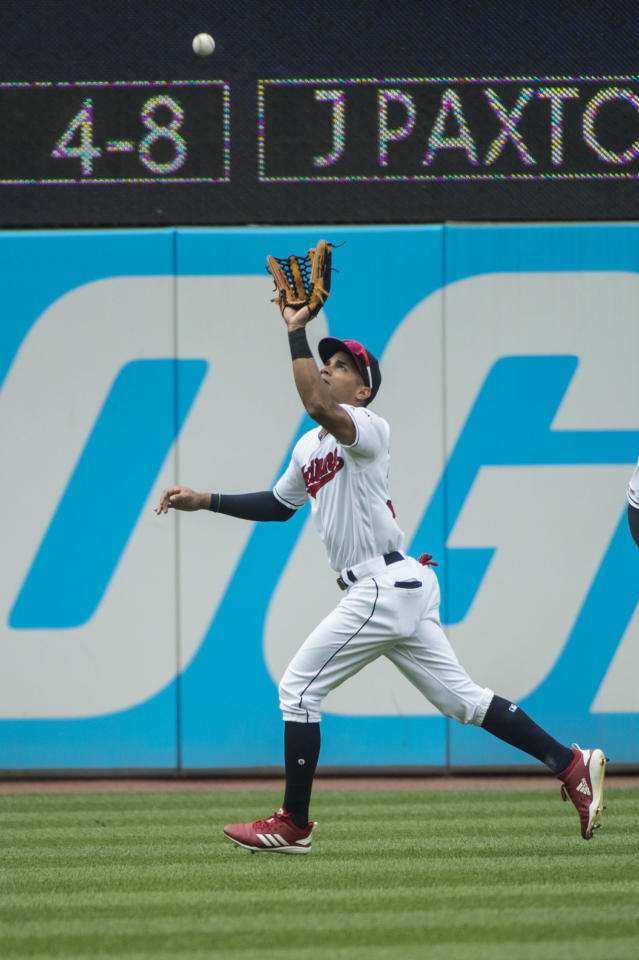 Cleveland Indians' Oscar Mercado prepares to catch a fly ball by Texas Rangers' Nomar Mazara during the third inning of the first game of a baseball doubleheader in Cleveland, Wednesday, Aug. 7, 2019. (AP Photo/Phil Long)
