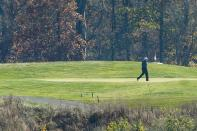 U.S. President Donald Trump plays golf after the 2020 U.S. presidential election was called for Democratic presidential candidate former Vice President Joe Biden at the Trump National Golf Club in Sterling, Virginia