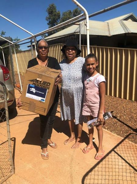 A coronavirus care package organised by Fortescue Metals Group and its partners is delivered to members of the Njamal Community near Port Hedland
