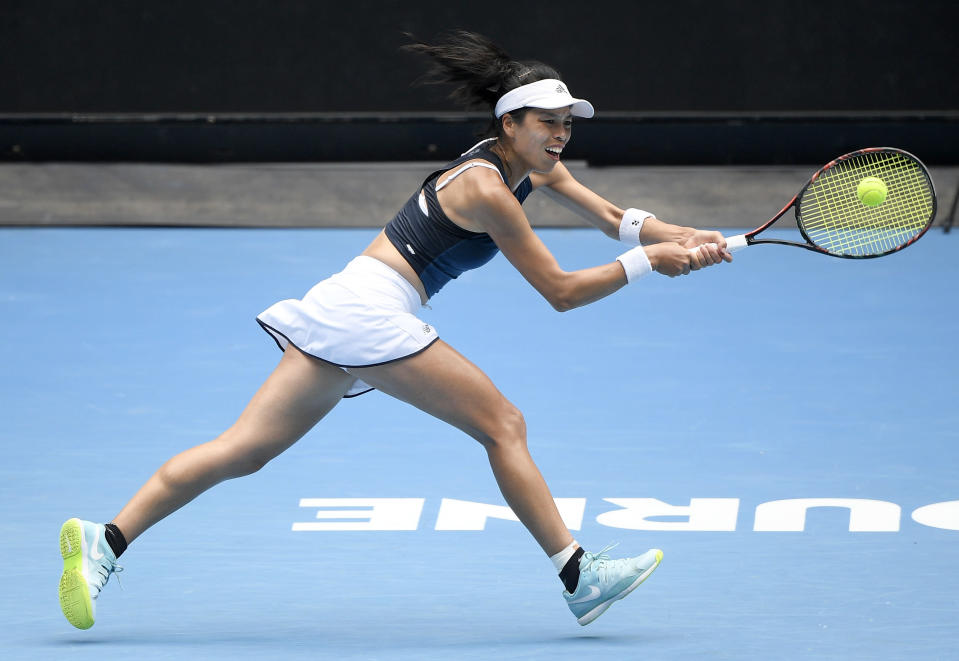 Taiwan's Hsieh Su-Wei hits a backhand to Marketa Vondrousova of the Czech Republic during their fourth round match at the Australian Open tennis championships in Melbourne, Australia, Sunday, Feb. 14, 2021. (AP Photo/Andy Brownbill)