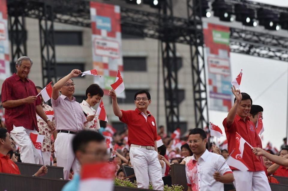 Finance Minister Heng Swee Keat (centre) at National Day Parade celebrations at The Float at Marina Bay on 9 August 2018. (Yahoo News Singapore file photo)
