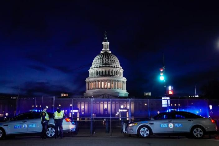 The U.S. Capitol is seen behind heavy-duty security fencing the day after supporters of U.S. President Donald Trump stormed the Capitol in Washington