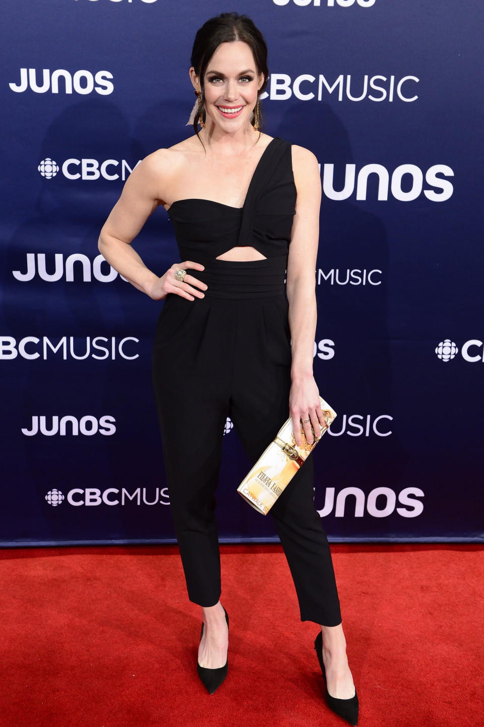 <p>The Olympic gold medalist ruled the red carpet in a one-shouldered pantsuit with cutout detailing. </p>