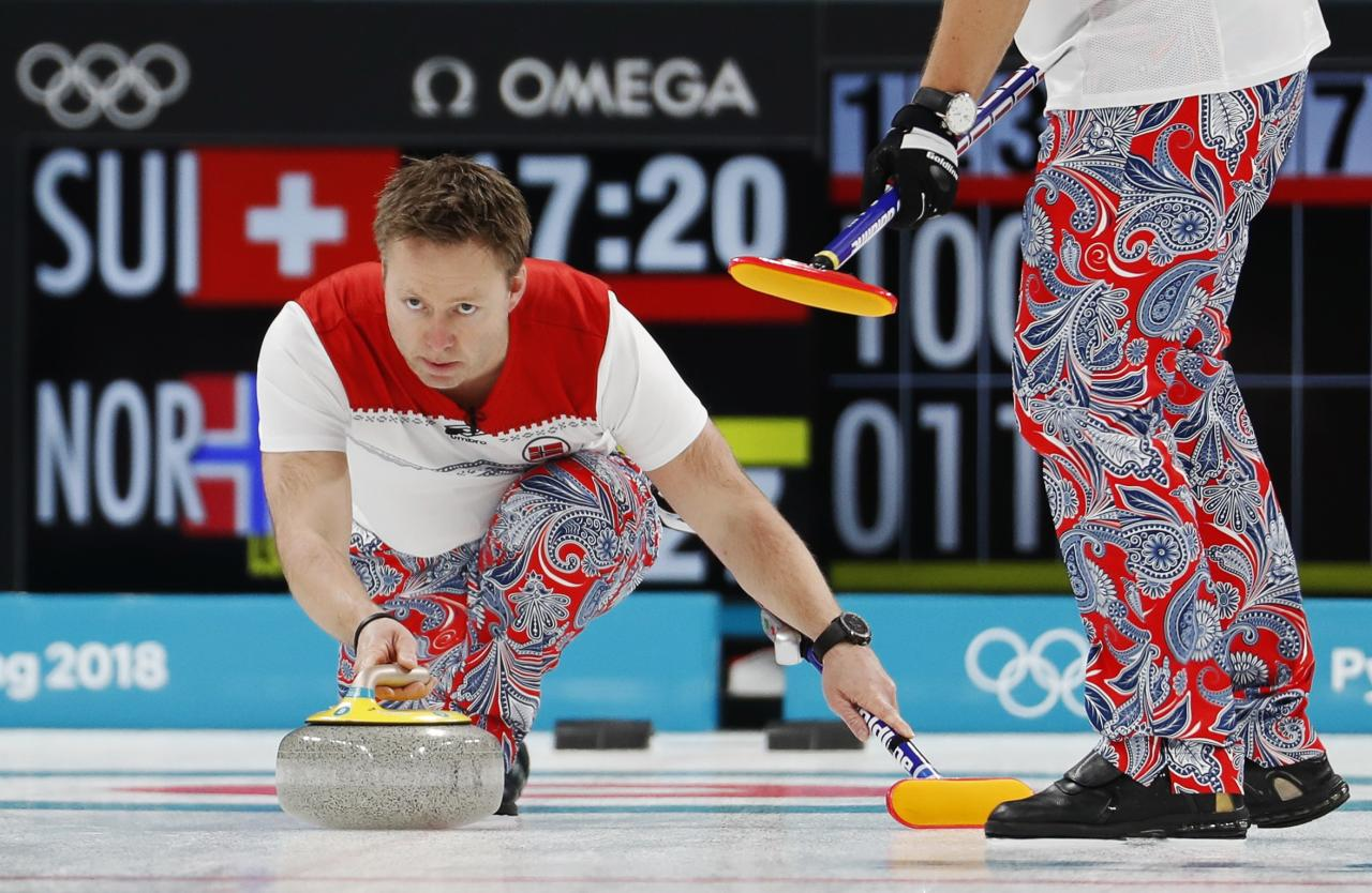 Curling - Pyeongchang 2018 Winter Olympics - Men's Round Robin - Switzerland v Norway - Gangneung Curling Center - Gangneung, South Korea - February 17, 2018 - Christoffer Svae of Norway delivers a stone. REUTERS/Cathal McNaughton