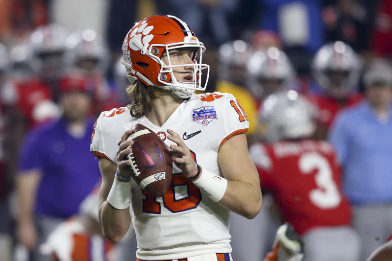 Clemson quarterback Trevor Lawrence looks for a receiver during the first half of the team's Fiesta Bowl NCAA college football playoff semifinal against Ohio State on Saturday, Dec. 28, 2019, in Glendale, Ariz.(AP Photo/Ross D. Franklin)