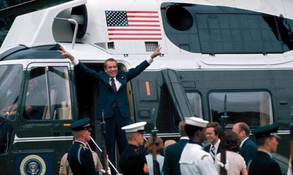 Richard Nixon gestures in the doorway of helicopter after leaving White House following his resignation over the Watergate scandal, on 9 August 1974.