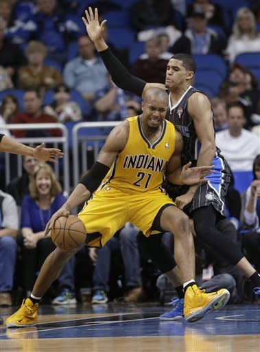 Indiana Pacers' David West (21) make a move to the basket around Orlando Magic's Tobias Harris during the first half of an NBA basketball game, Friday, March 8, 2013, in Orlando, Fla. (AP Photo/John Raoux)