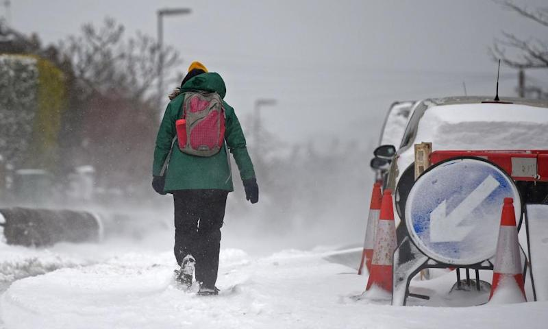A woman walks through the snow in the village of Marsden, east of Manchester.