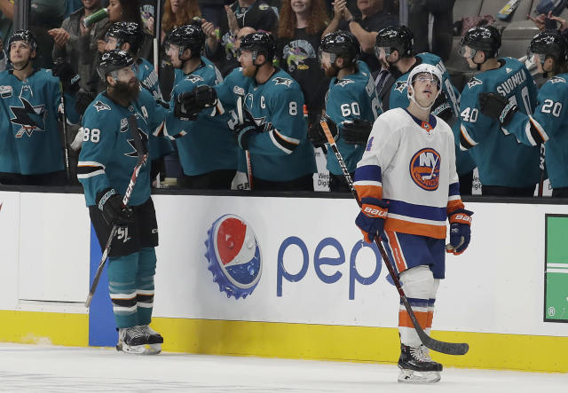 San Jose Sharks defenseman Brent Burns (88) celebrates with teammates after scoring a goal as New York Islanders defenseman Thomas Hickey, right, looks toward the scoreboard during the second period of an NHL hockey game in San Jose, Calif., Saturday, Oct. 20, 2018. (AP Photo/Jeff Chiu)