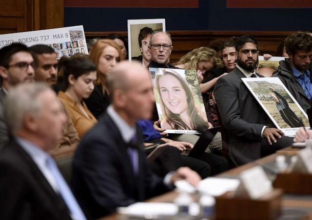 PHOTO: Family members of those who died aboard Ethiopian Airlines Flight 302 hold photos of their loved ones as Dennis Muilenburg, President and CEO of the Boeing Company, testifies before congressional lawmakers Washington, Oct. 30, 2019. (Olivier Douliery/AFP via Getty Images)