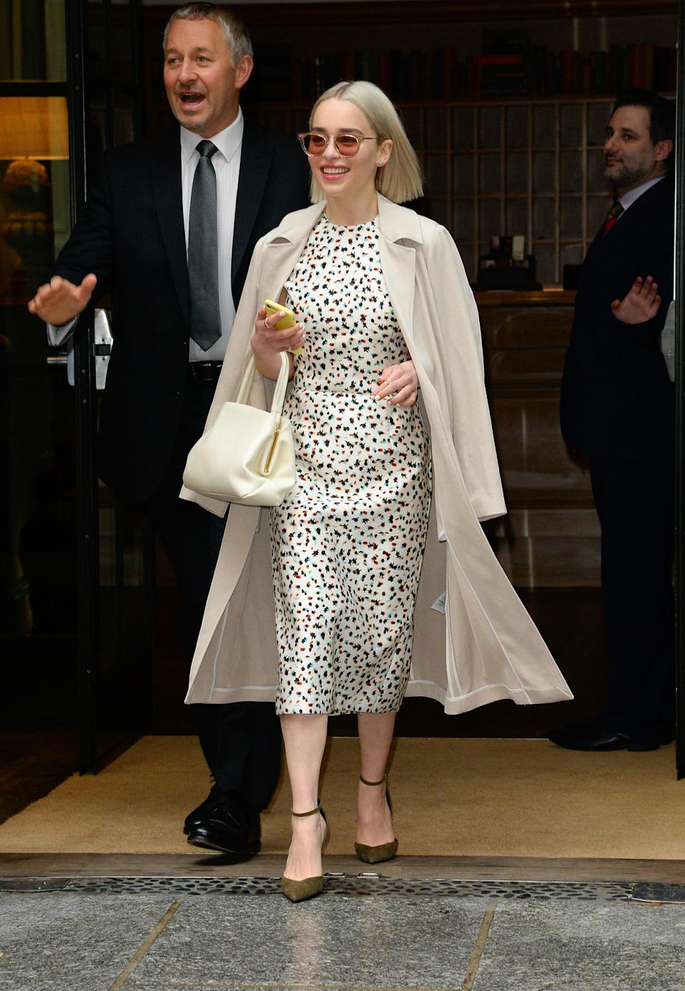 <p>Emilia looked oh-too chic in a polka dot dress with vream coat and accessories as she headed to make an appearance on 'Good Morning America'. <em>[Photo: Getty]</em> </p>