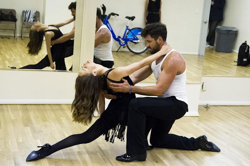 "FILE - In this June 28, 2013 photo, dancers Karina Smirnoff, left, and Maksim Chmerkovskiy rehearse for the upcoming Broadway show ""Forever Tango"" in New York. Smirnoff and Chmerkovskiy, best known for their work on ""Dancing with the Stars,"" will star in the revival of Luis Bravo's ""Forever Tango,"" which traces the dance's birth on the streets of 19th-century Buenos Aires to its more modern manifestations. (Photo by Charles Sykes/Invision/AP, File)"