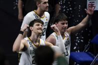Baylor guard Matthew Mayer, left, celebrates as he walks off the court at the end of a men's Final Four NCAA college basketball tournament semifinal game against Houston, Saturday, April 3, 2021, at Lucas Oil Stadium in Indianapolis. Baylor won 78-59. (AP Photo/Darron Cummings)