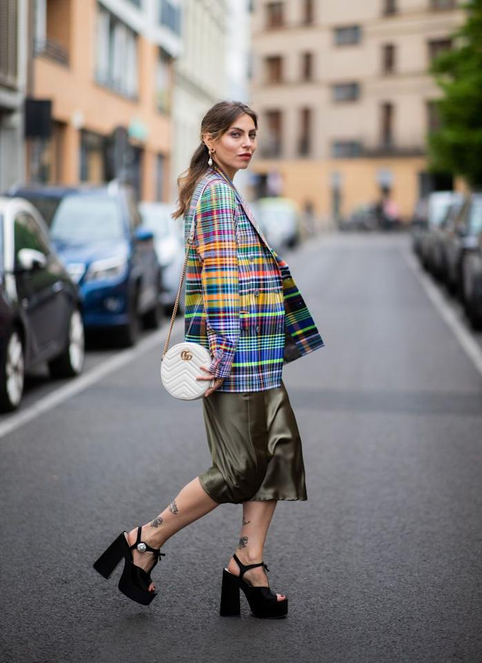 """<p>Don't be afraid to mix and match pieces that seemingly don't go together. This chic silky skirt and colorful blazer together are a perfect example of how a daring ensemble can work in your favor. Just be authentic and let the magic happen. </p><p><strong>What you'll need:</strong> </p><p>Topshop Sage Satin Skirt, $55 us.topshop.com</p><p><a class=""""body-btn-link"""" href=""""https://go.redirectingat.com?id=74968X1596630&url=https%3A%2F%2Fus.topshop.com%2Fen%2Ftsus%2Fproduct%2Fclothing-70483%2Fskirts-70504%2Ftallecbias-skirt-sage-8566215&sref=http%3A%2F%2Fwww.seventeen.com%2Ffashion%2Ftrends%2Fg27393289%2Fmidi-skirt-outfit%2F"""" target=""""_blank"""">Shop Now</a></p>"""