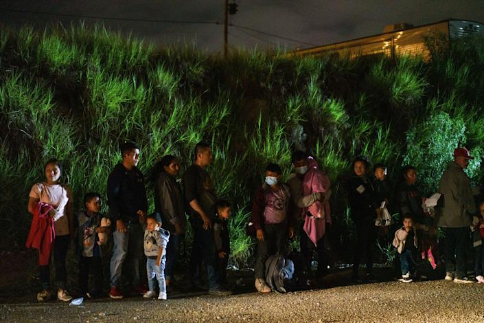 Migrant families are lined up after crossing the U.S.-Mexico border in Roma, Texas on July 9, 2021. / Credit: PAUL RATJE/AFP via Getty Images