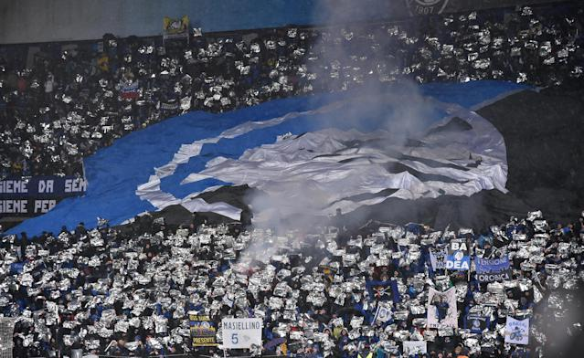 Soccer Football - Europa League Round of 32 Second Leg - Atalanta vs Borussia Dortmund - Stadio Atleti Azzurri, Bergamo, Italy - February 22, 2018 Atalanta fans set off a smoke bomb REUTERS/Alberto Lingria
