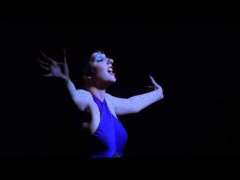 "<p>Rather than recreate Liza Minnelli's performance, in <em>Fosse/Verdon</em>, actress Kelli Barrett simply practices ""Cabaret"" by the piano, under Fosse's watchful eye. The music is layered over scenes of Verdon trekking to New York and back in search of the perfect gorilla costume, all to help Fosse's movie-but the audience knows when she returns to Berlin, her husband will have betrayed her once again.</p><p><a href=""https://www.youtube.com/watch?v=BcLUC7yj7vY"" rel=""nofollow noopener"" target=""_blank"" data-ylk=""slk:See the original post on Youtube"" class=""link rapid-noclick-resp"">See the original post on Youtube</a></p>"