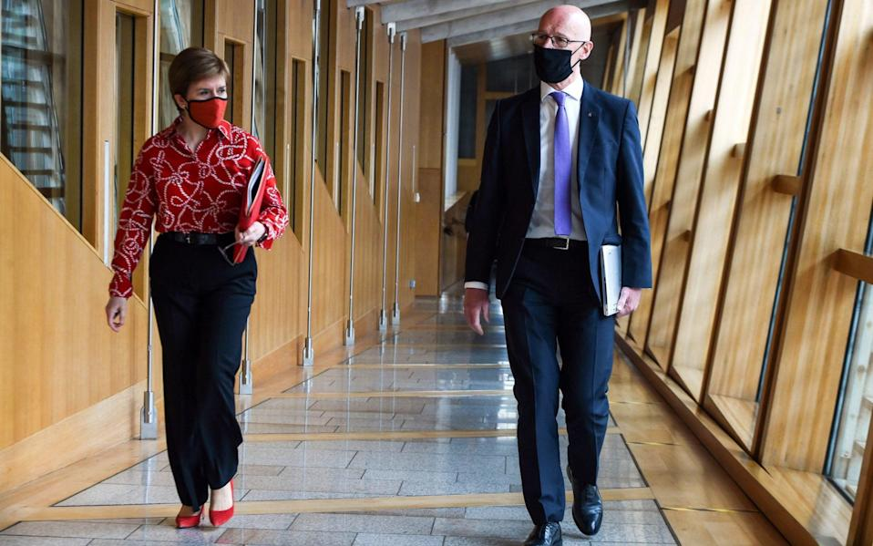 First Minister of Scotland and SNP leader Nicola Sturgeon and Deputy First Minister John Swinney -  Andy Buchanan/PA