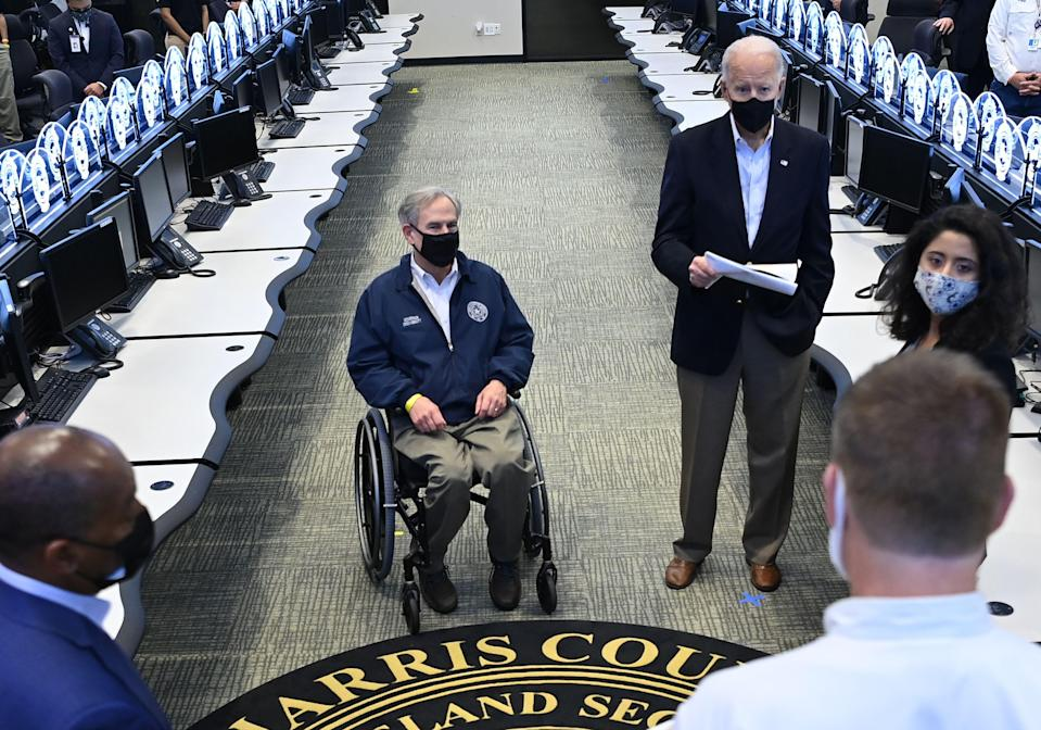 <p>US President Joe Biden and Texas Governor Greg Abbott listen to officials at the Harris County Emergency Operations Center in Houston, Texas.</p> (Photo by MANDEL NGAN/AFP via Getty Images)