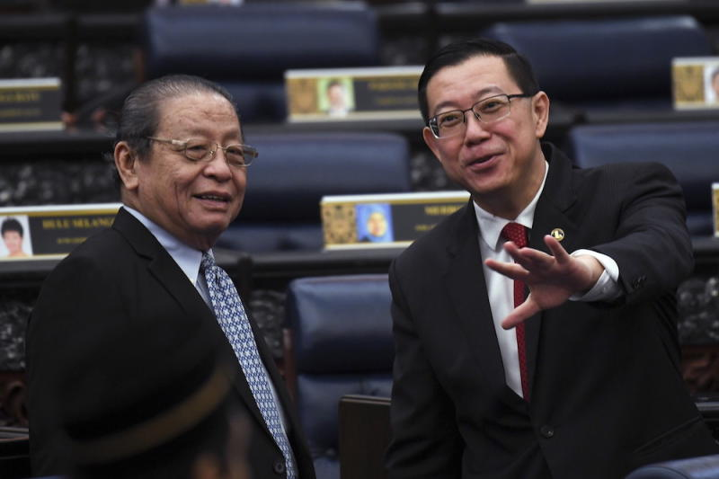 File picture shows Iskandar Puteri MP Lim Kit Siang with Minister of Finance Lim Guan Eng at the 14th Parliament sitting, July 16, 2018. — Bernama pic