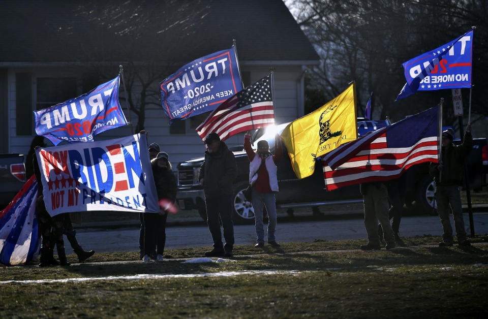 """FILE - In this March 3, 2021, file photo, supporters of former President Donald Trump demonstrate outside as first lady Jill Biden and Education Secretary Miguel Cardona visit Fort LeBoeuf Middle School in Waterford, Pa. State Sen. Doug Mastriano, R-Franklin, said in a statement Wednesday, July 7, 2021, that, as chair of the Senate Intergovernmental Operations Committee, he issued letters to several counties, requesting """"information and materials needed to conduct a forensic investigation of the 2020 General Election and the 2021 Primary."""" (Mandel Ngan/Pool Photo via AP, File)"""