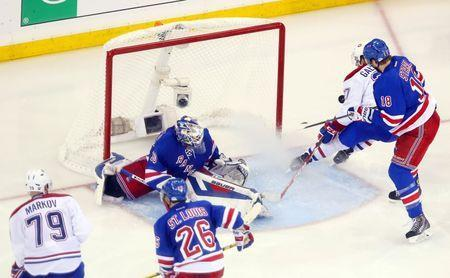 May 22, 2014; New York, NY, USA; Montreal Canadiens center Alex Galchenyuk (27) scores the game-winning goal past New York Rangers goalie Henrik Lundqvist (30) and defenseman Marc Staal (18) during the overtime period in game three of the Eastern Conference Final of the 2014 Stanley Cup Playoffs at Madison Square Garden. Ed Mulholland-USA TODAY Sports