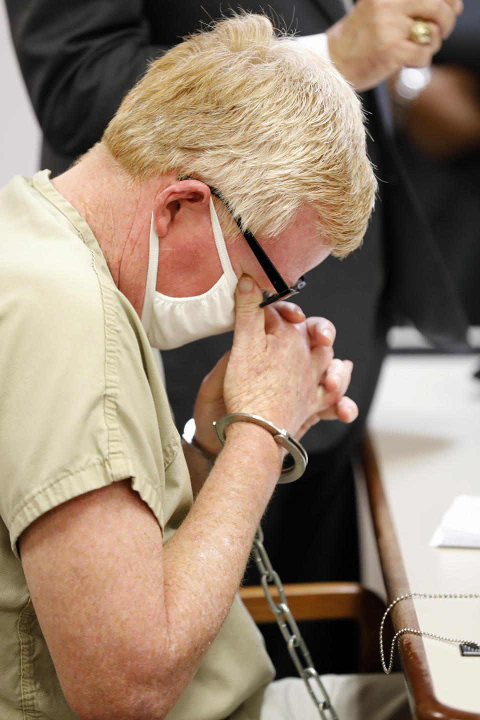 Alex Murdaugh weeps during his bond hearing, Thursday, Sept. 16, 2021, in Varnville, S.C. Murdaugh surrendered Thursday to face insurance fraud and other charges after state police said he arranged to have himself shot in the head so that his son would get a $10 million life insurance payout. (AP Photo/Mic Smith)